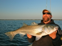 Capt_Dave_with_Fly_Rod_Striper